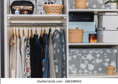The wardrobe, closet in which everything put in order. All things are folded neatly. Many boxes. Everything is in its place. Harmony. Concept. Interior. Clothing. Underwear. Underwear.
