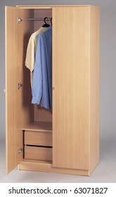 wardrobe with clothes on a plain background