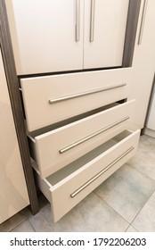 Wardrobe drawers slightly open example