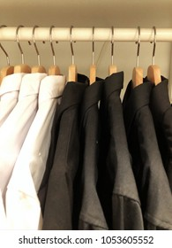 Man's wardrobe full of white and black shirts