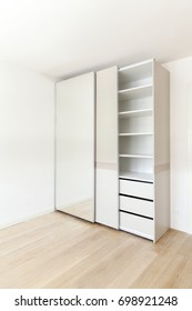 wardrobe with mirror in an empty room