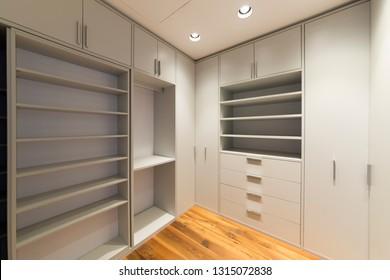 Wardrobe room with empty shelves