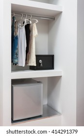 wardrobe safe lock and mini bar of a room in a hotel