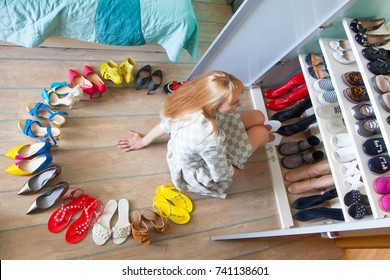 Wardrobe. Shelves for shoes. Storage and order in the closet.