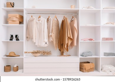 Wardrobe with stylish female clothes