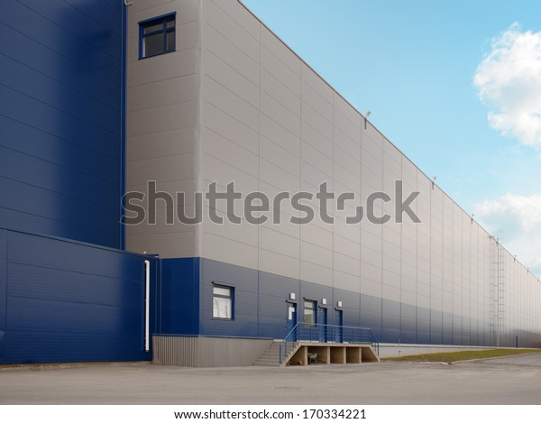Warehouse with blue sky