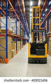warehouse boxes and forklift stacker loader
