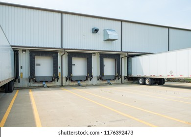 Warehouse building with 53 foot dry van trailers backed into docking doors