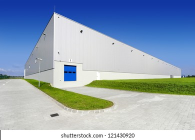Warehouse building with blue sky
