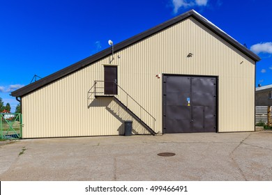 Warehouse building with metal doors and a surveillance camera