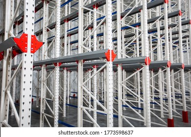 Warehouse Cantilever Racking Systems for storage Aluminum Pipe or profiles. Pallet Rack and Industrial Warehouse Racking. Steel profiles. Interior of Empty Big Huge Warehouse.