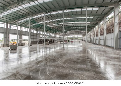 warehouse construction site, steel structure, concrete polished floor and roof is done