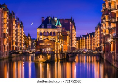 The Warehouse District (Speicherstadt) in Hamburg, Germany at night. View of Wandrahmsfleet. The largest warehouse district in the world is located in the port of Hamburg within the HafenCity quarter.