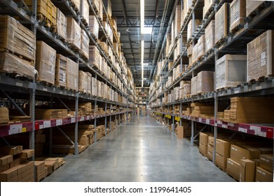 Warehouse full of blank cardboard boxes stacked on shelves under industrial lights