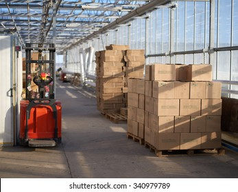 warehouse with glass walls and boxes stored