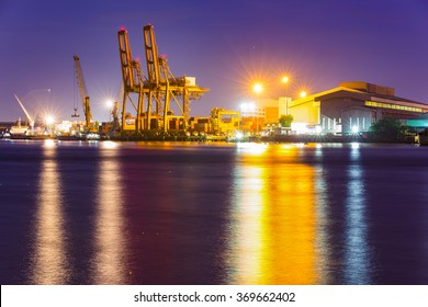 Warehouse Godown, Container Cargo freight ship with working crane loading bridge in shipyard for Logistic Import Export background.