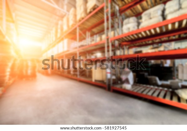 Warehouse industrial and logistics companies. The boxes on high shelves stocked. Bright sunlight. Deep blur effect.