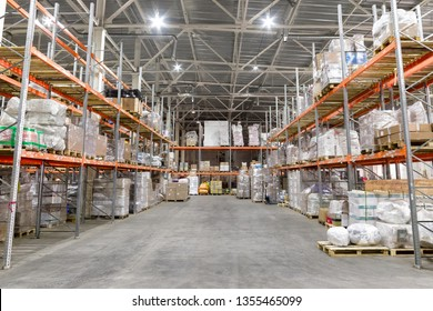 Warehouse industrial and logistics companies. Long shelves with a variety of boxes and containers
