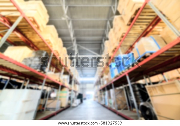 Warehouse industrial and logistics companies. Long shelves with a variety of boxes and containers. Deep blur effect.