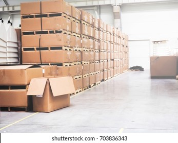 Warehouse industrial premises for storing materials and wood, there is a forklift for containers. Concept logistics, transport. ot of boxes in the warehouse
