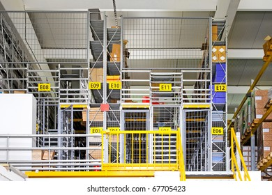 Warehouse interior with safety cage rooms
