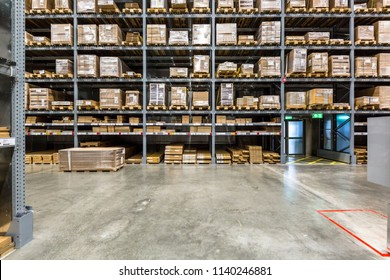 Warehouse interior with shelves rack for keep production material, pallets and boxes.