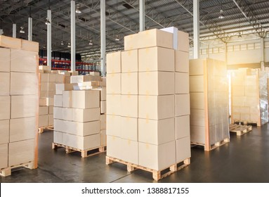 Warehouse inventory and management. stack of cardboard boxes on wooden pallet in distribution warehouse.