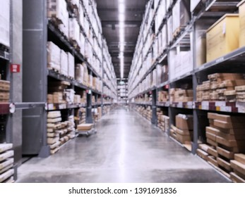 It is a warehouse of a large-scale shopping center, Rows of shelves with boxes, Blurred business background.