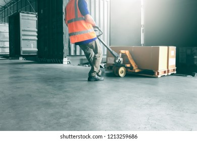 Warehouse loader are dragging the shipment pallet unloading out of a truck.