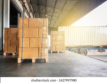 Warehouse and Logistics, Courier cargo shipment transportation. Stacked of cardboard boxes on wooden pallet for load into a truck.
