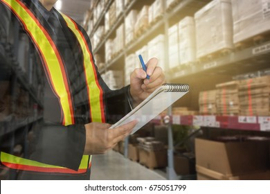 Warehouse man with safety equipment working check stock chart for Logistic Import Export concept on Warehouse background