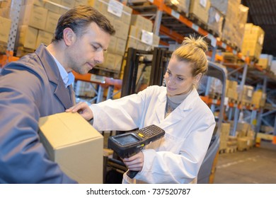 warehouse management system worker with barcode scanner