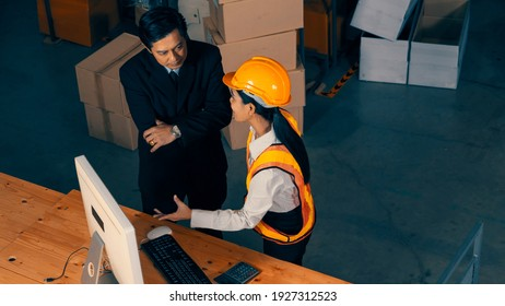 Warehouse manager and worker working in the storehouse . Logistics , supply chain and warehouse business concept .