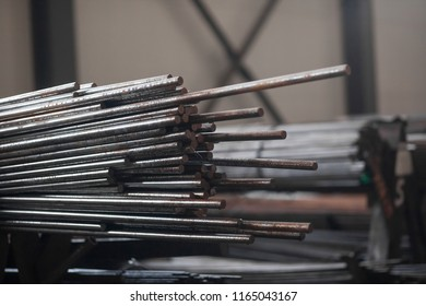 Warehouse of a metal bar of pipes