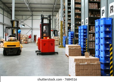 Warehouse with pallet trucks working