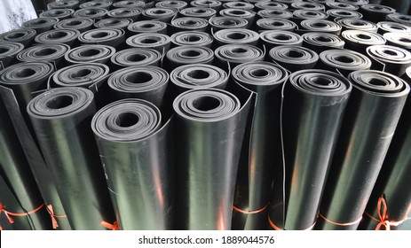 warehouse rolls of rubber. black coating rolls.