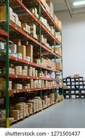 Warehouse shelves loaded with cardboard boxes