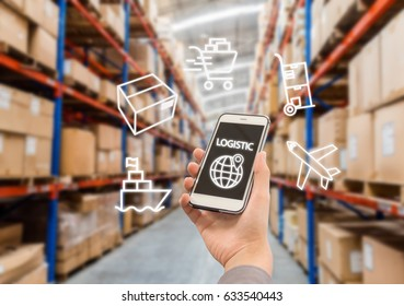 Warehouse storage of retail merchandise shop. Businessman checking inventory in stock room of a manufacturing company on smartphone