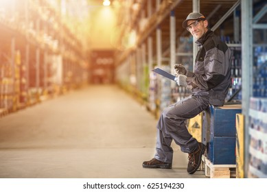 Warehouse Supervisor Job. Caucasian Worker Making Documentation in the Storage Facility.