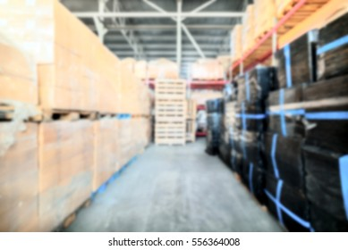 Warehouse transport and freight company. A stack of cardboard boxes. Deep blur effect. Abstract industrial background.