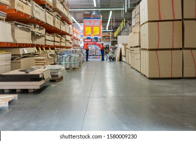 Warehouse tree. Pallets with wooden plates in a warehouse or in a hangar. Lumber production