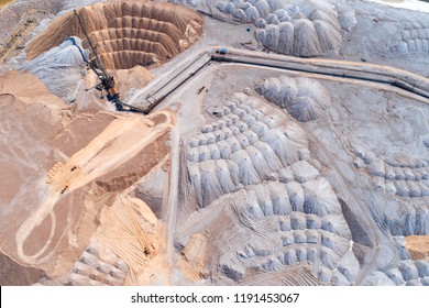 Warehouse of unused rock. Ore is stored in huge mounds. A system of long belt conveyors and spreaders