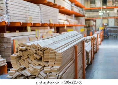 Warehouse with variety of timber for construction and repair. Delivery concept.