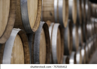 warehouse of wooden barrels with beer and wine