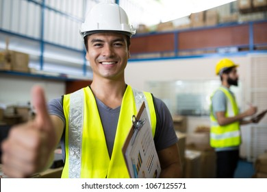 Warehouse worker checking stock products in store