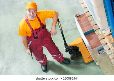 warehouse worker with fork pallet truck stacker
