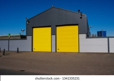 Warehouse with yellow roller doors