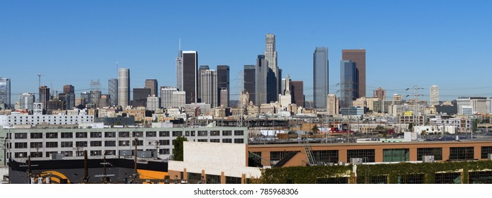 Warehouses and industrial buildings dominate the foreground of this urban view in Los Angeles