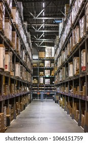 Warehouses with shelves, goods in wholesale store. linear perspective.