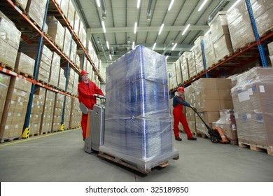 Warehousing - Two workers in uniforms working in storehouse